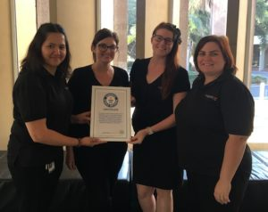 Mackay Box Office staff with certificate after world record tap dancing lesson